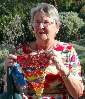 Margaret Doecke shows off Bright Plastic Pennant Flag made from Bread Bags