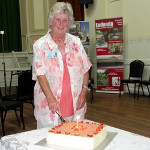 Eudundas Citizen of the Year - Pam Dutschke cutting the Heritage Gallery Birthday Cake - Feb 2017