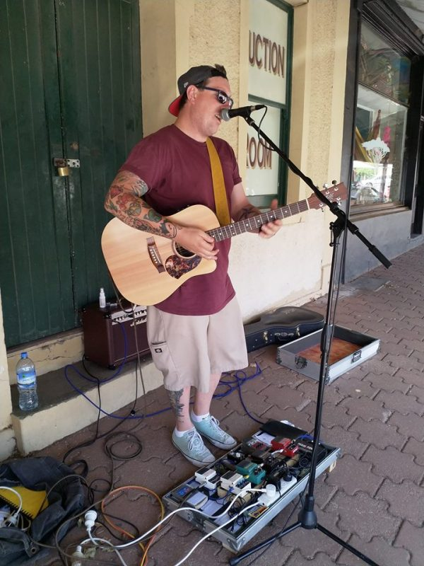 Peter Noble Student Minister busking in Eudunda 300119